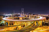 Complex Spiral Approach Bridg At Night
