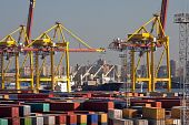 stock photo of international trade  - Containers loading at the sea trading port - JPG