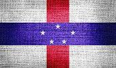 Netherlands Antilles flag on burlap fabric