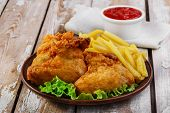 fried chicken wings in batter with french fries