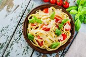 fettuccine pasta with tomatoes and parmesan cheese
