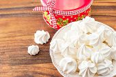 Many Small White Meringue Cookies With Round Christmas Gift Box