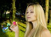 Blonde Blowing Soap Bubbles