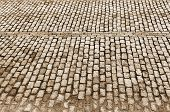 Urban Road Is Paved With Blocks Of Stone, Cobblestone Walkway, Sepia
