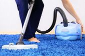 image of dirty-laundry  - Powelful vacuum cleaner in action - JPG