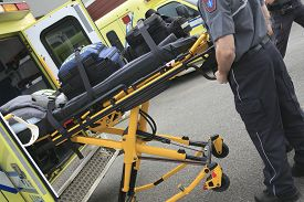 image of ambulance  - Paramedic employee with ambulance in the background - JPG