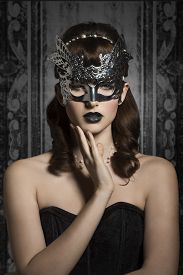 stock photo of venice carnival  - Mysterious carnival elegant gorgeous female in silver mask with black lips and old fashioned hairstyle - JPG