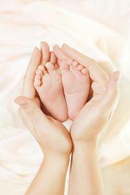foto of foot  - Baby Newborn Feet in Mother Hands - JPG