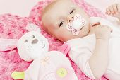 picture of teats  - portrait of three months old baby girl with a toy - JPG
