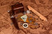 image of treasure map  - Old compass lying on antique map with treasure chest - JPG