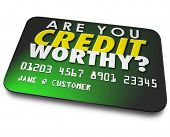 picture of borrower  - Are You Credit Worthy words on a plastic card asking if your score - JPG