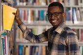picture of single man  - A Portrait Of An Caucasian College Student Man In Library  - JPG