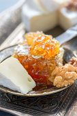 foto of brie cheese  - Breakfast with honey nuts and brie cheese on a bronze tray - JPG