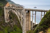 foto of bixby  - California Coastline near Big Sur south of San Francisco beautiful seascape with cloudy sky and colorful landscape and historic Bixby Bridge in highway 1 - JPG
