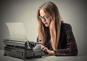 foto of typewriter  - Woman using a typewriter - JPG