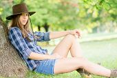 image of cowgirl  - Cute cowgirl restung under the tree - JPG