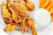image of chicken wings  - A dish of chicken hot wings and carrots with dipping sauce - JPG