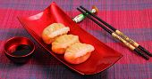 stock photo of siomai  - steamed shrimp dumplings served on a traditional bamboo place mat - JPG
