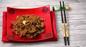 pic of stir fry  - Vietnamese beef stir fry served on a wood table top - JPG