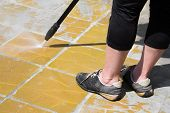 stock photo of water jet  - Worker is cleaning anexternal floor with a high pressure water - JPG