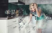 stock photo of vapor  - Creative photo of a astonished woman cook frying lunch in a oven - JPG