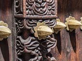 image of carving  - Horizontal close up photo of an old traditional wooden carved door in Stone Town, Zanzibar, Tanzania, East Africa, with typical metal elements and carved floral ornaments. ** Note: Shallow depth of field - JPG