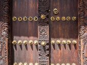 picture of carving  - Horizontal photo of an old traditional wooden carved door in Stone Town - JPG
