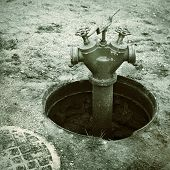 stock photo of manhole  - old red fire hydrant in manhole cover - JPG