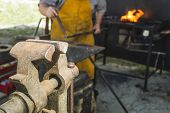 image of blacksmith shop  - Vise and anvil in a forge shop - JPG