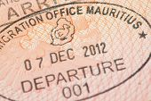 image of mauritius  - Passport page with Mauritius immigration control departure stamp with traditional Dodo bird depicted on it. ** Note: Shallow depth of field - JPG