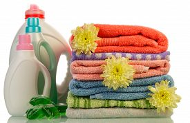 foto of detergent  - Detergent in bottles and towels isolated on white background - JPG