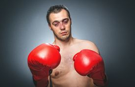 picture of knockout  - Funny boxer man with closed eyes in knockout over dark gray background - JPG