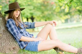 image of cowgirls  - Cute cowgirl restung under the tree - JPG
