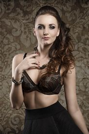 foto of up-skirt  - fashion brunette woman posing with cute bra and black skirt - JPG