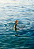 hand of man in open sea