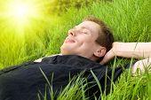 young man relax under summer sun
