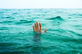hand of man in salt ocean water