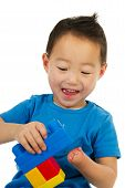 picture of physically handicapped  - Happy Chinese boy with light handicap is playing with colorful blocs - JPG