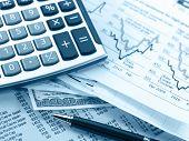 Financial concept. Calculator and pen.  shallow DOF.