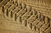 stock photo of off_road  - tread pattern of a truck tire in soft sand - JPG