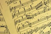 Hand-written music score with yellow background