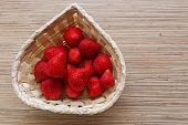 Defrozen Strawberries In A Basket. Closeup Of A Basket Full Of Defrozen Juicy Strawberries poster