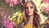 Beautiful Young Model Spring Girl   In Flowers With Hairstyle In Summer Blossom Park. Woman In A Blo poster