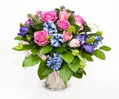 stock photo of lilas  - bouquet of lilas and roses in glass vase - JPG