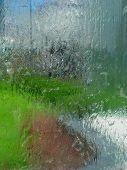 Water running down glass pane