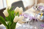 Bouquet of tulips for Easter table setting poster