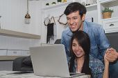 Couples Concept. Lovers Are Playing In The Living Room. Couples Are Shopping Through The Internet. L poster