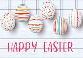 Happy Easter. Pending Easter Eggs On White Wooden Background. Easter Colorful Hanging Eggs With Simp poster