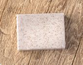The Cocos  Soap Bar  Over Wooden Background poster
