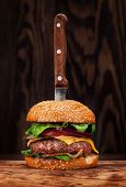 Tasty grilled home made burger with beef, tomato, cheese, cucumber and lettuce poster